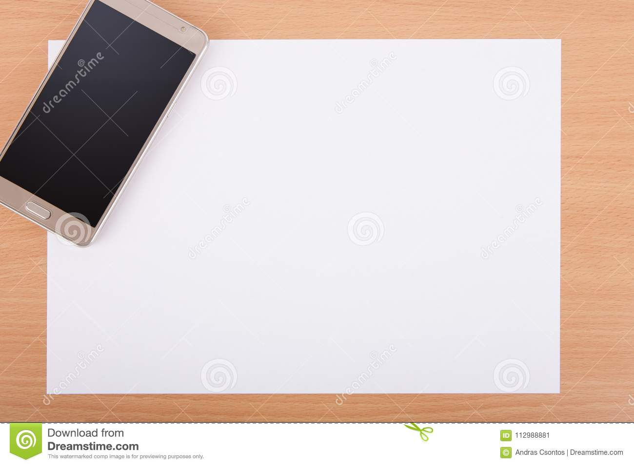 Blank A4 white paper with a smartphone on an office desk