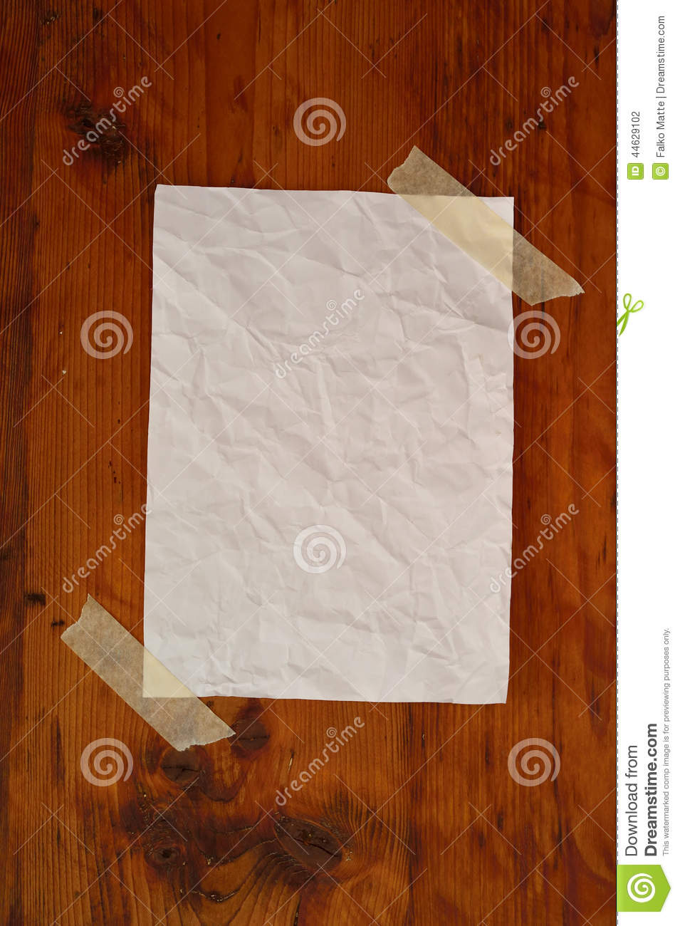 Blank white paper on wood grain surface