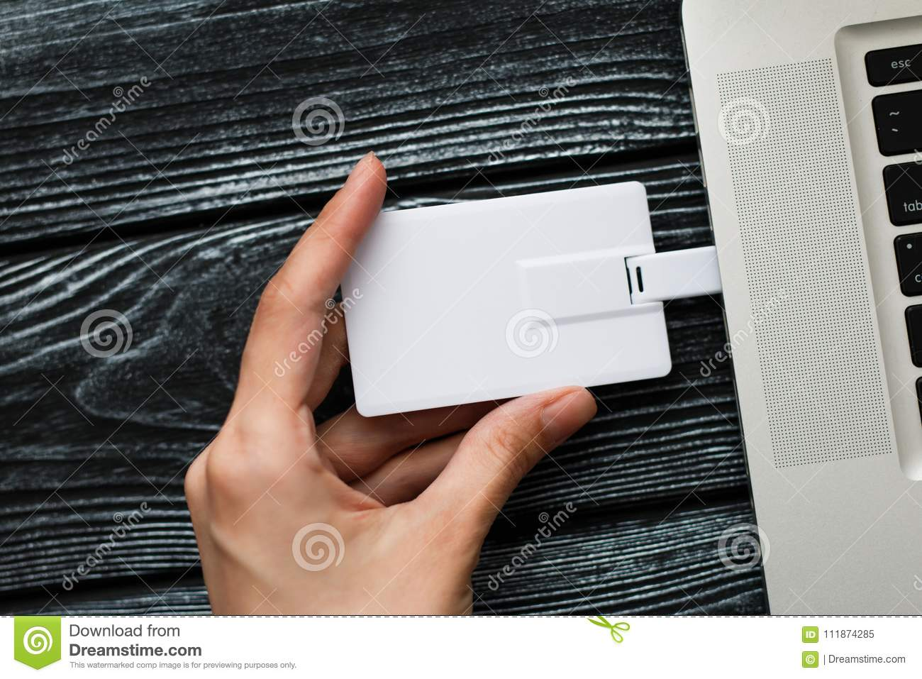 Hand inserting usb flash drive into computer laptop stock image download comp reheart Gallery