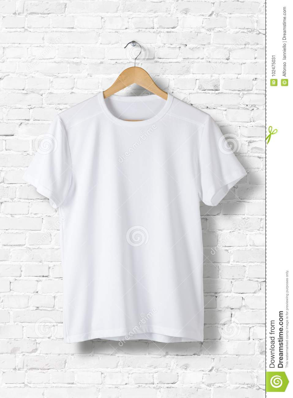 Blank White T-Shirt Mock-up hanging on white wall, front side view.