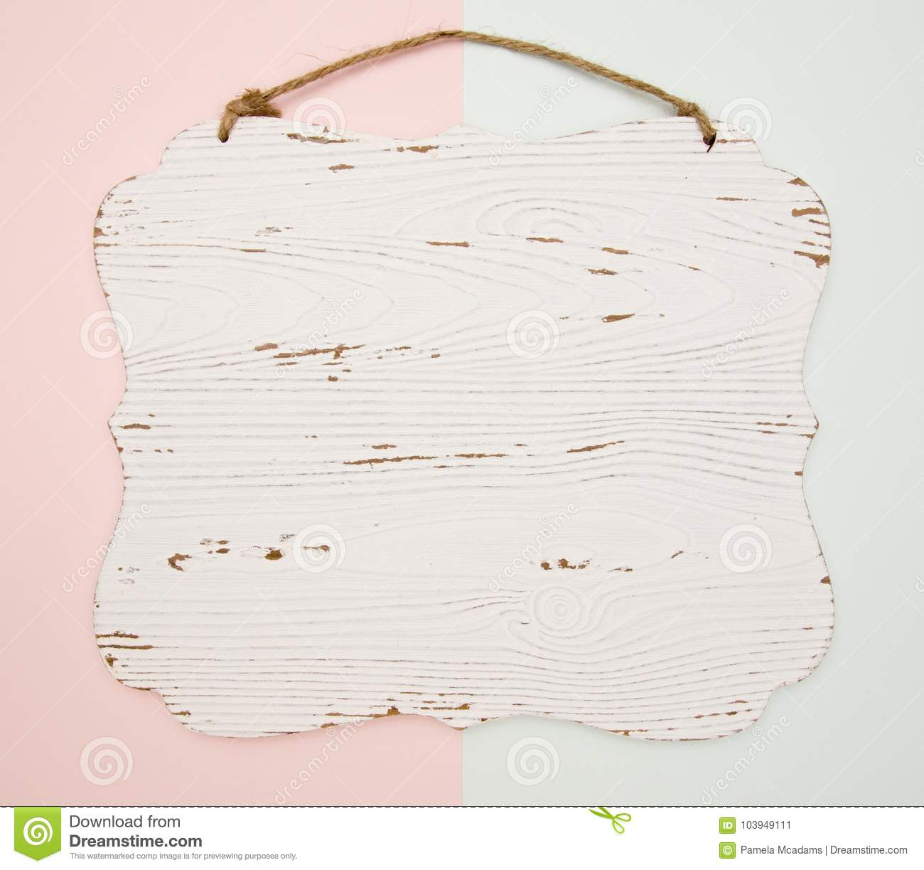 Blank Wooden Carved Hanging On A Blue And Pink Background