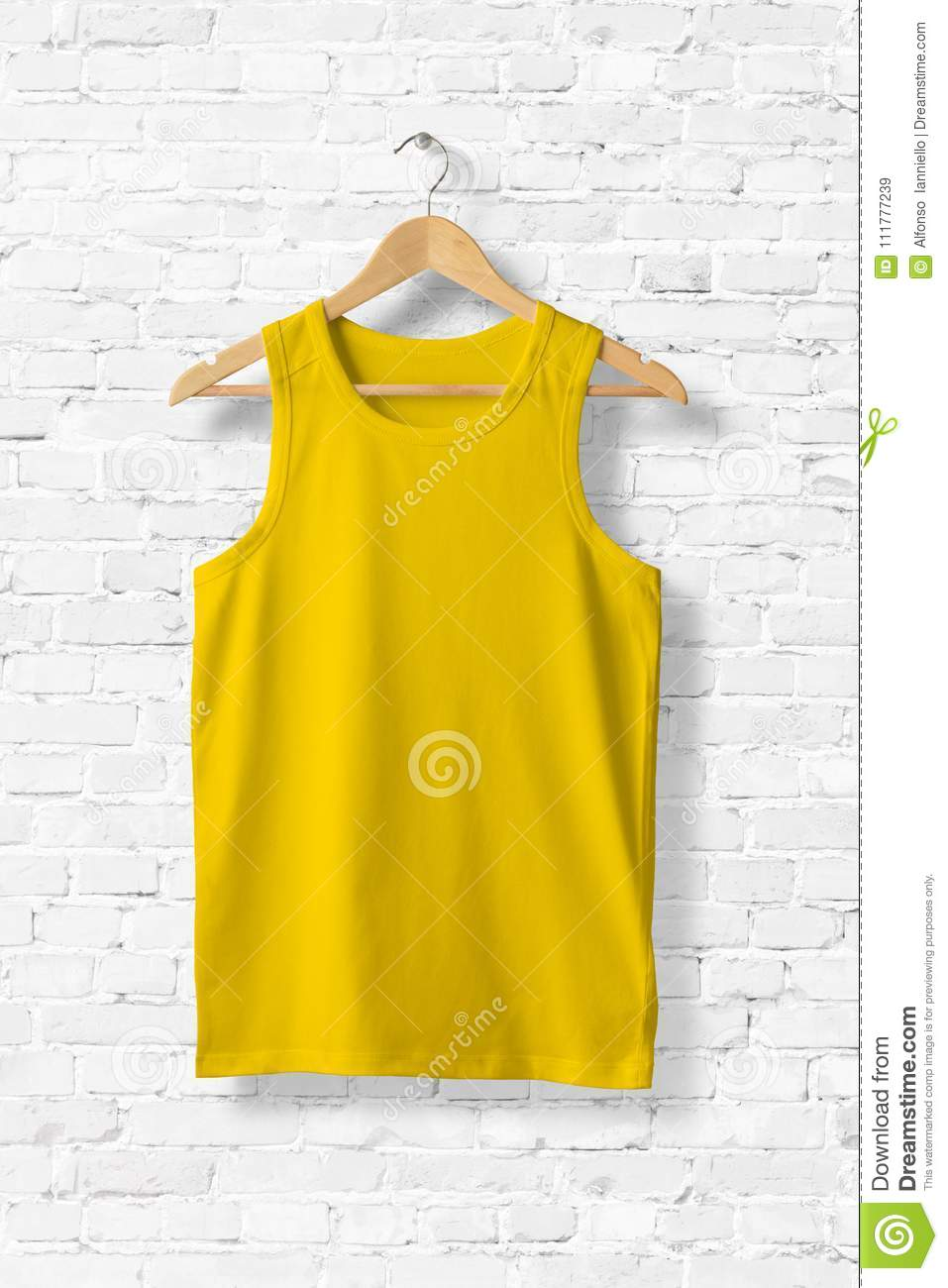 Blank Yellow Tank Top Mock-up hanging on white wall.
