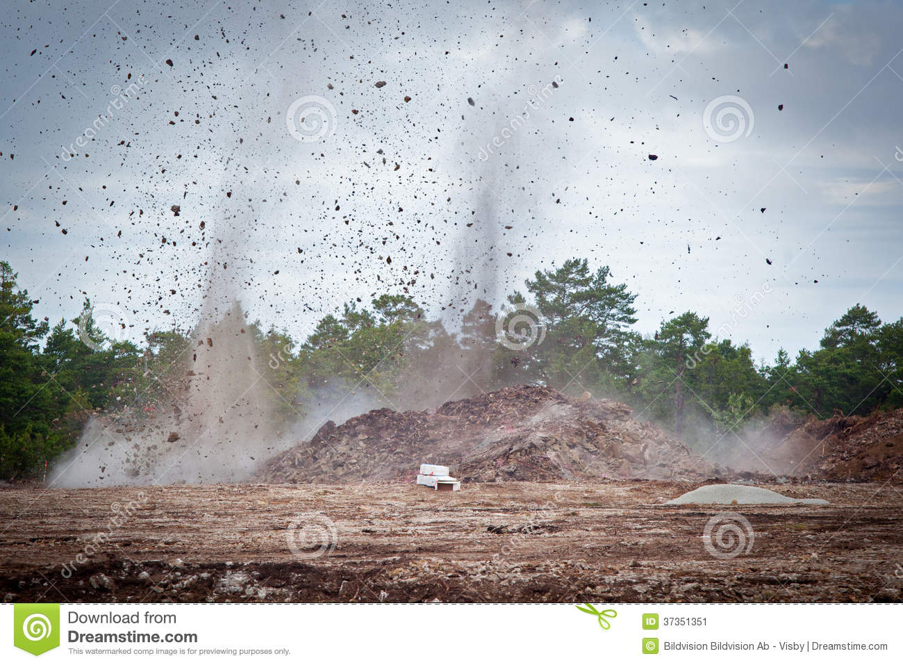 Blasting limestone in a stock image image for Landscape rock quarry alberta