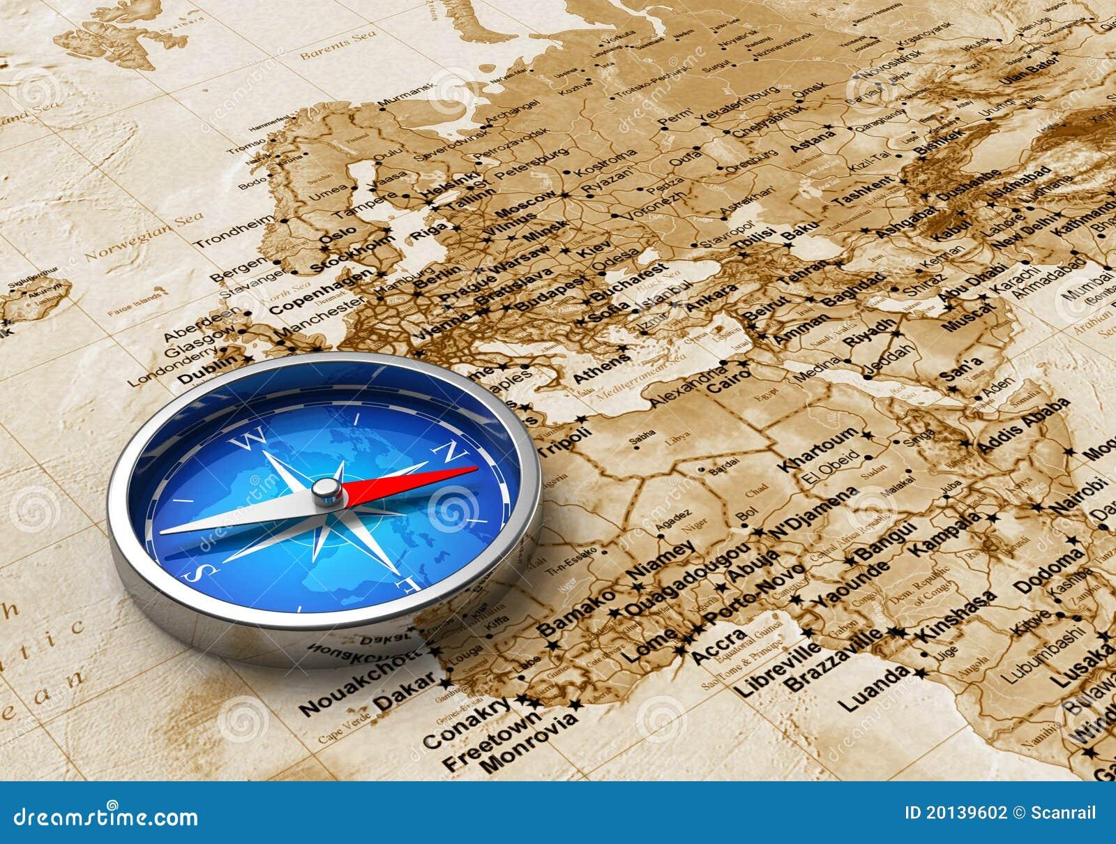 Blauer Metallkompaß auf der Weltkarte