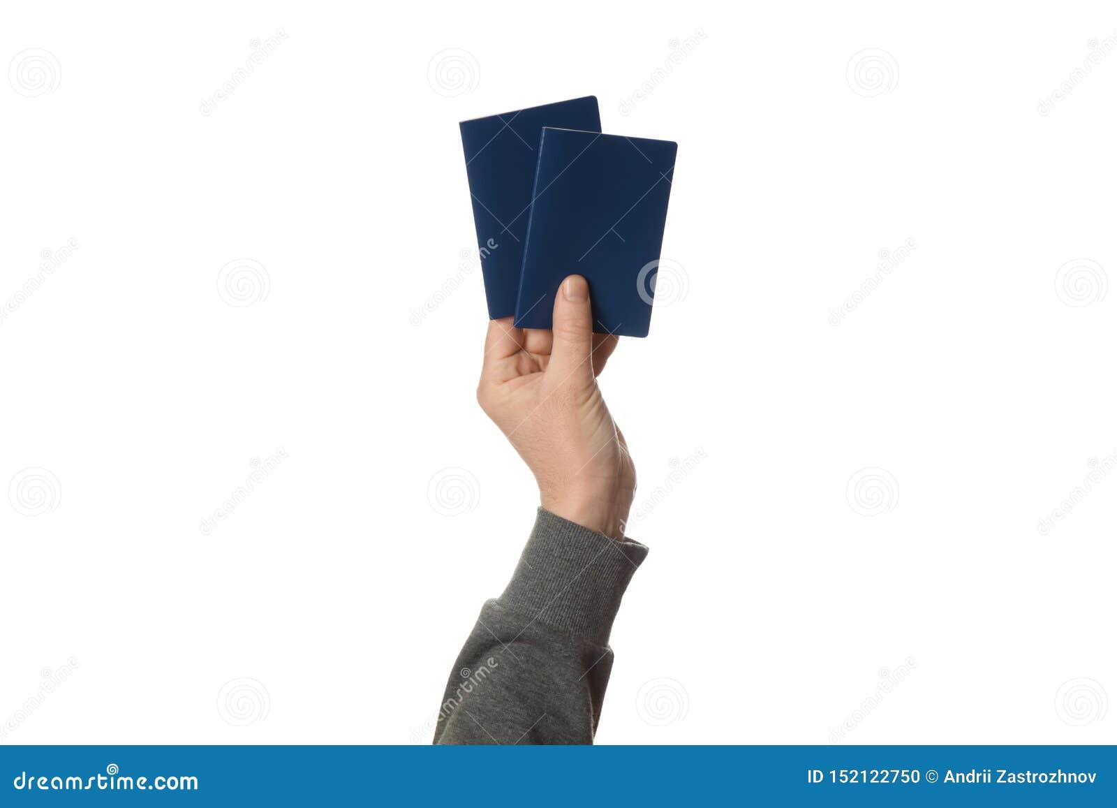 Blauer Pass in der Hand lokalisiert auf wei?em Hintergrund Zollkontrolle und Reise