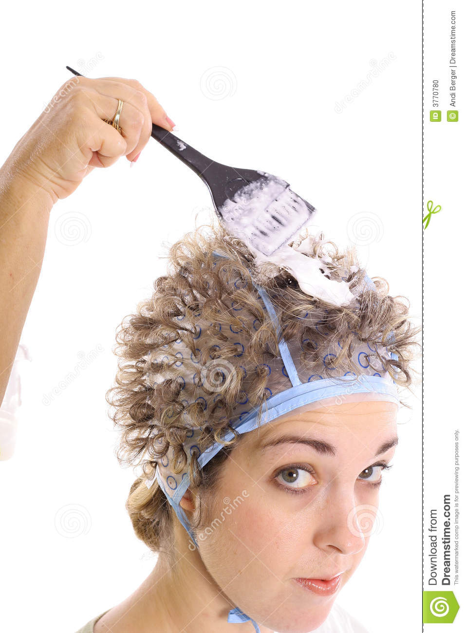 Bleaching hair with bleach upclose isolated on white background.
