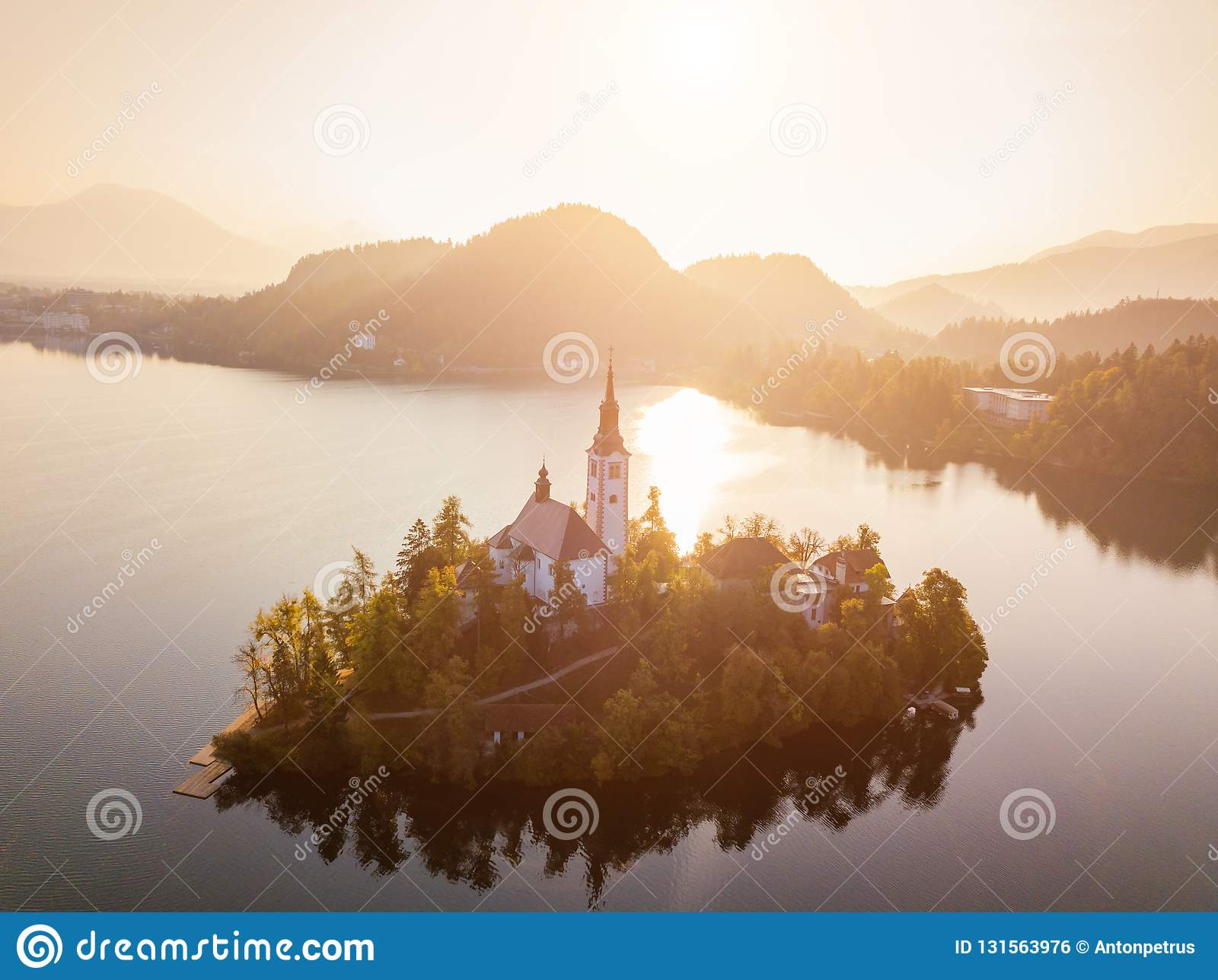 Bled Lake with Pilgrimage Church of the Assumption of Maria at sunrise. Aerial view