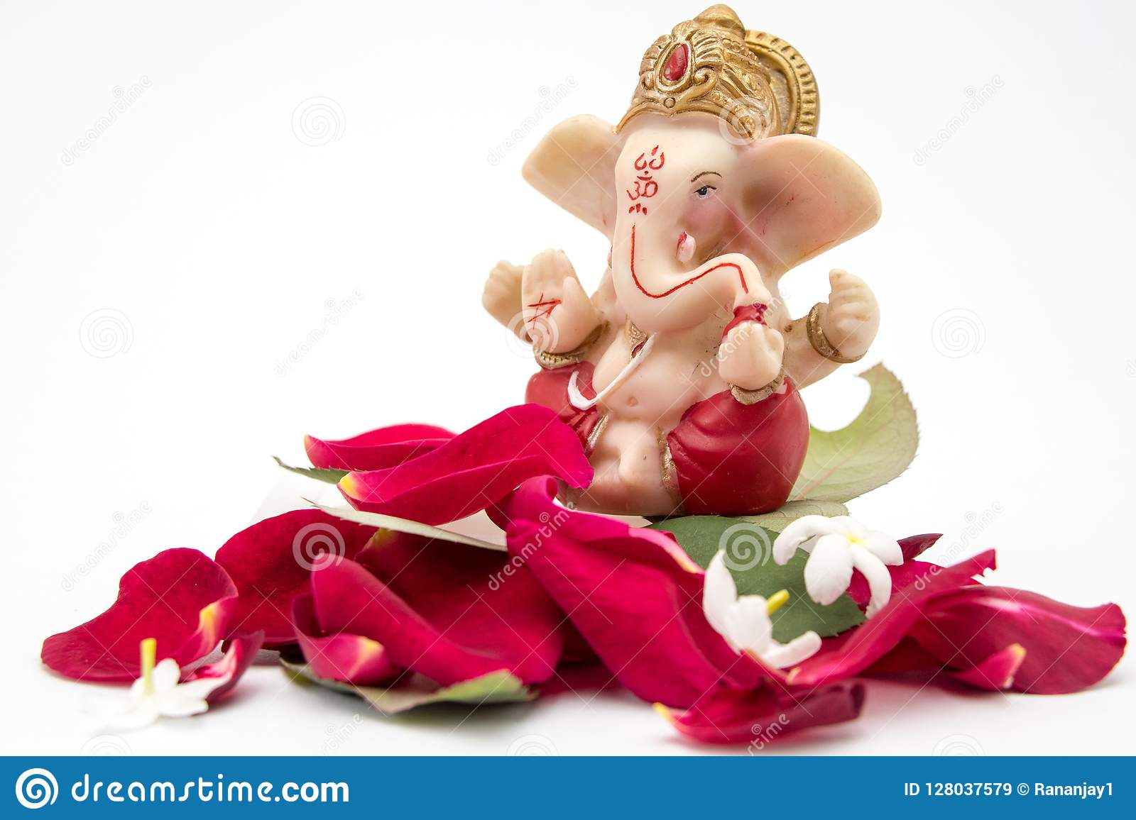 Lord Ganesha Idol With Rose Petals White Flowers And Leaves On