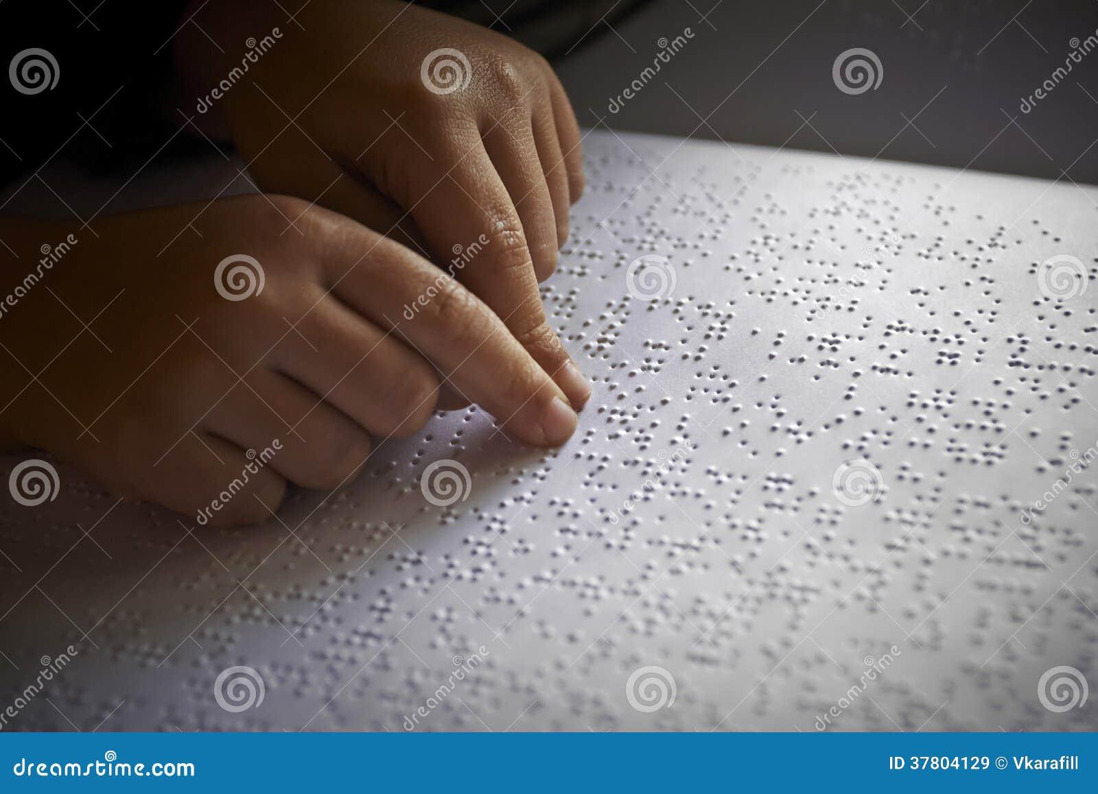 Blind children read text in braille