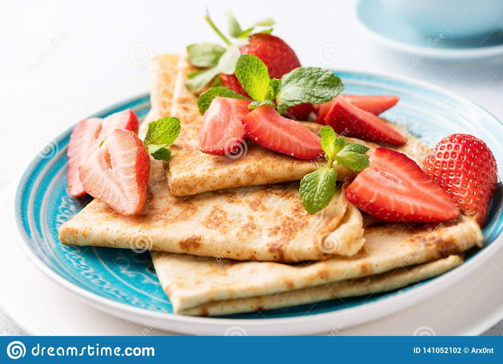 Blini or crepes with strawberry