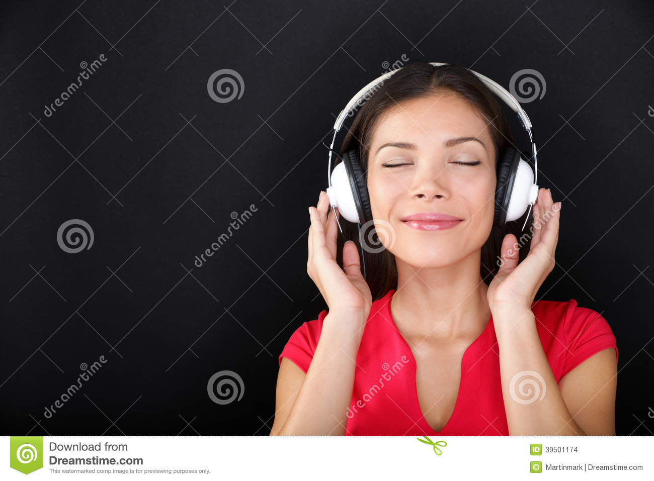 Blissful beautiful woman listening to music