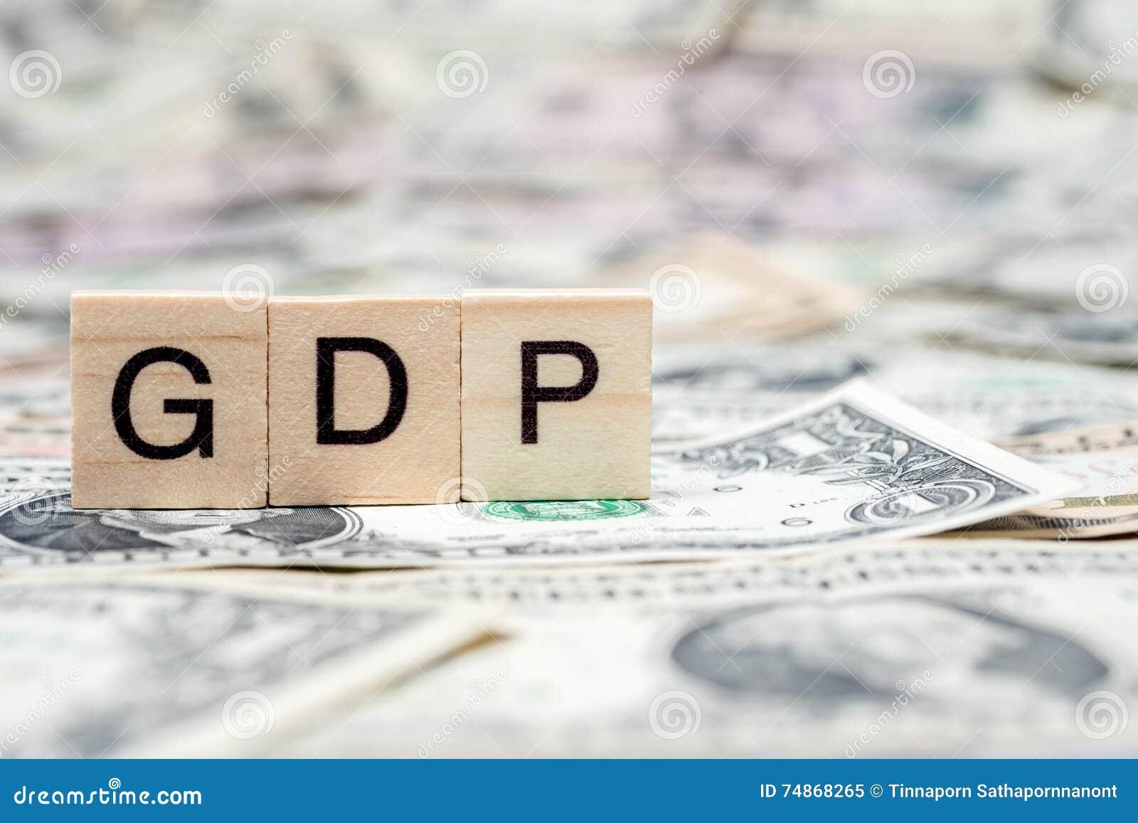 Bloc en bois de PIB ou de produit intérieur brut sur le billet de banque de dollar US