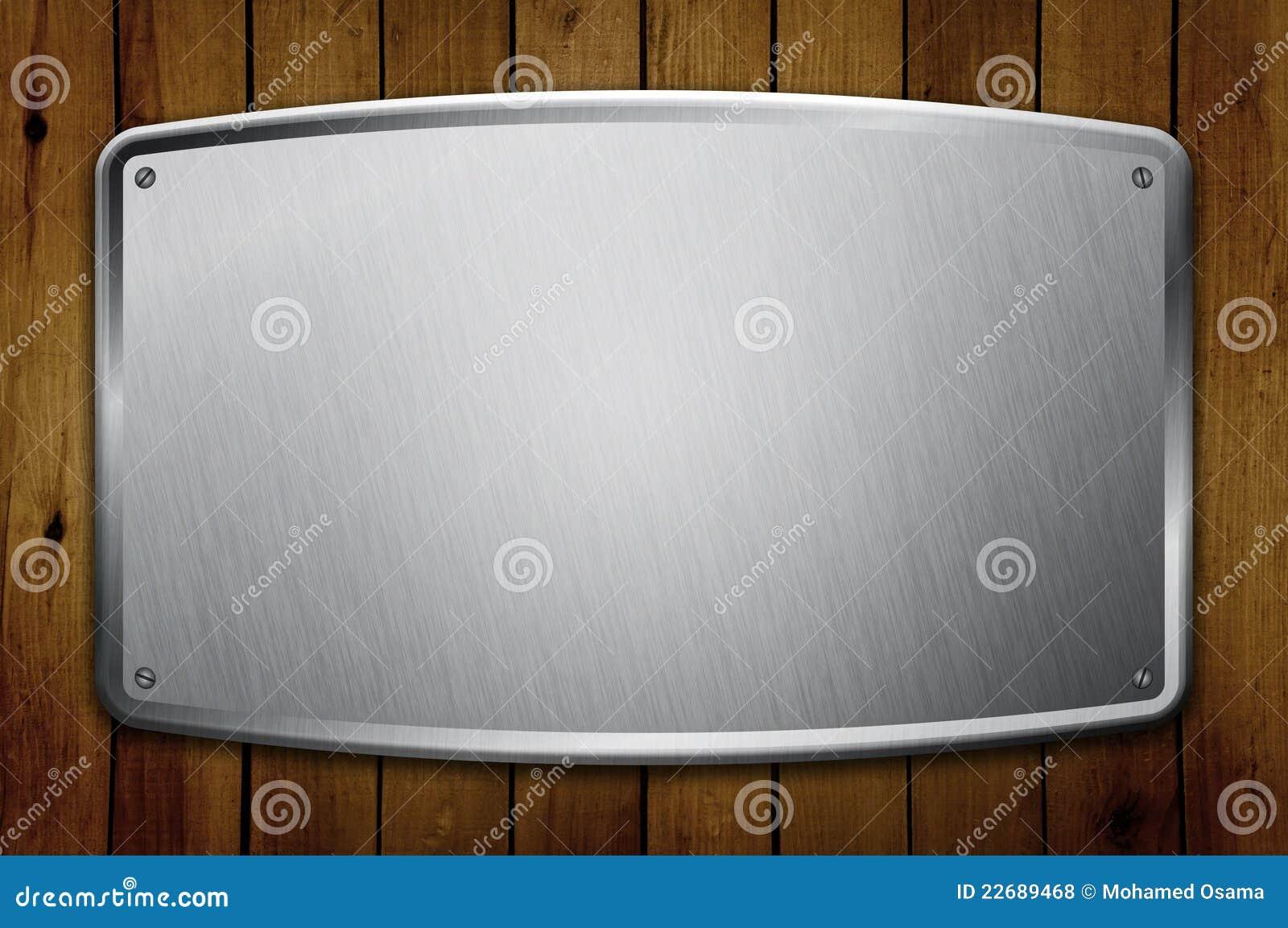 Blocco per grafici in bianco del metallo sulla parete di legno