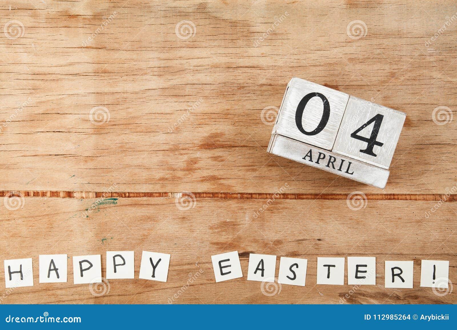 Block calendar on white background. 4 april
