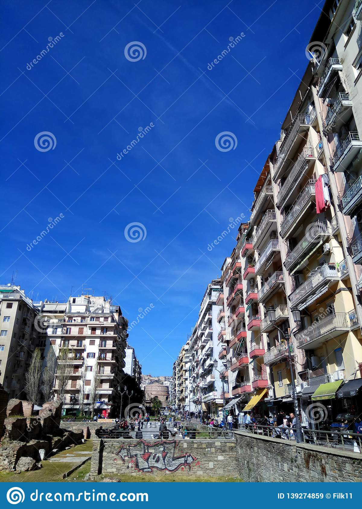 Thessaloniki, Greece - April 3 2018: Apartment buildings at Navarinou street around the remains of palace of Galerius.