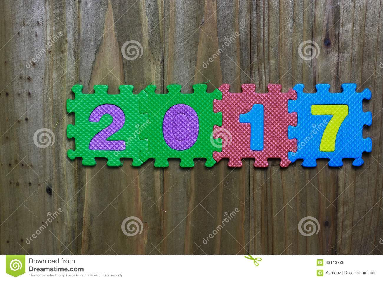 Block letters and numbers 2017 with wood background