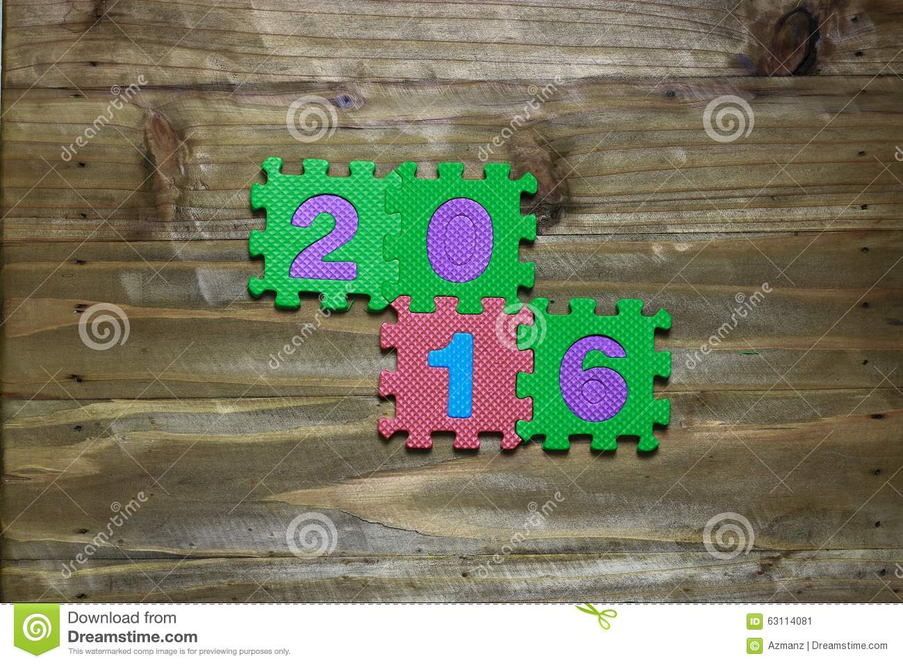 Block letters and numbers 2016 with wood background