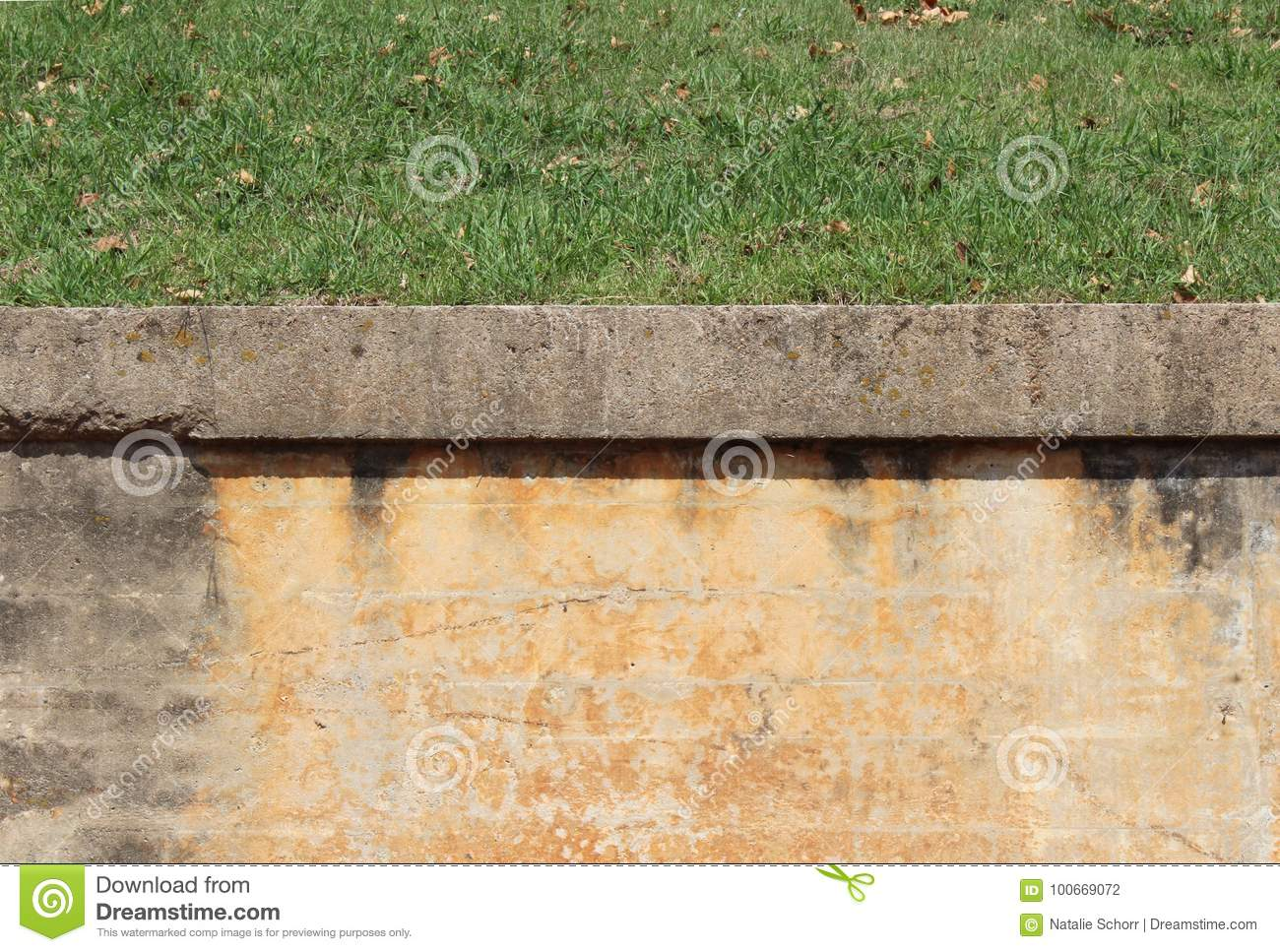 Block Retaining Wall With Plaster Finish, Concrete Cap, And Grass ...