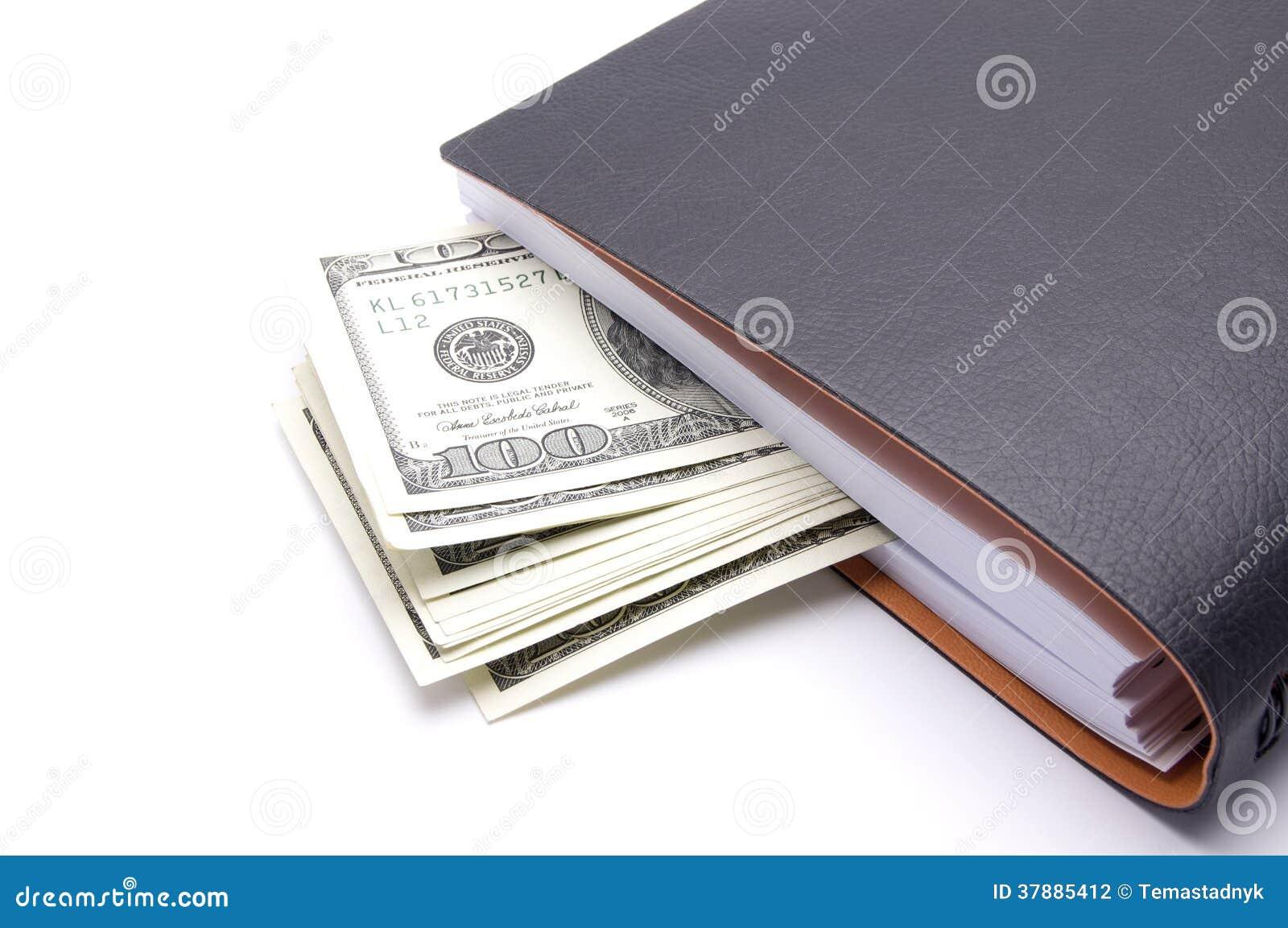 Blocnote met geld op witte achtergrond