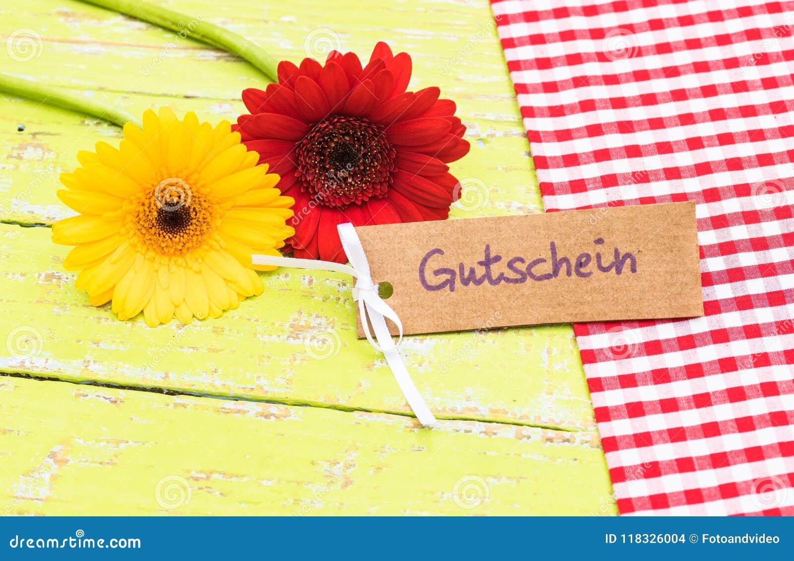 Bloemen en giftkaart met Duitse woord, Gutschein, middelenbon of coupon
