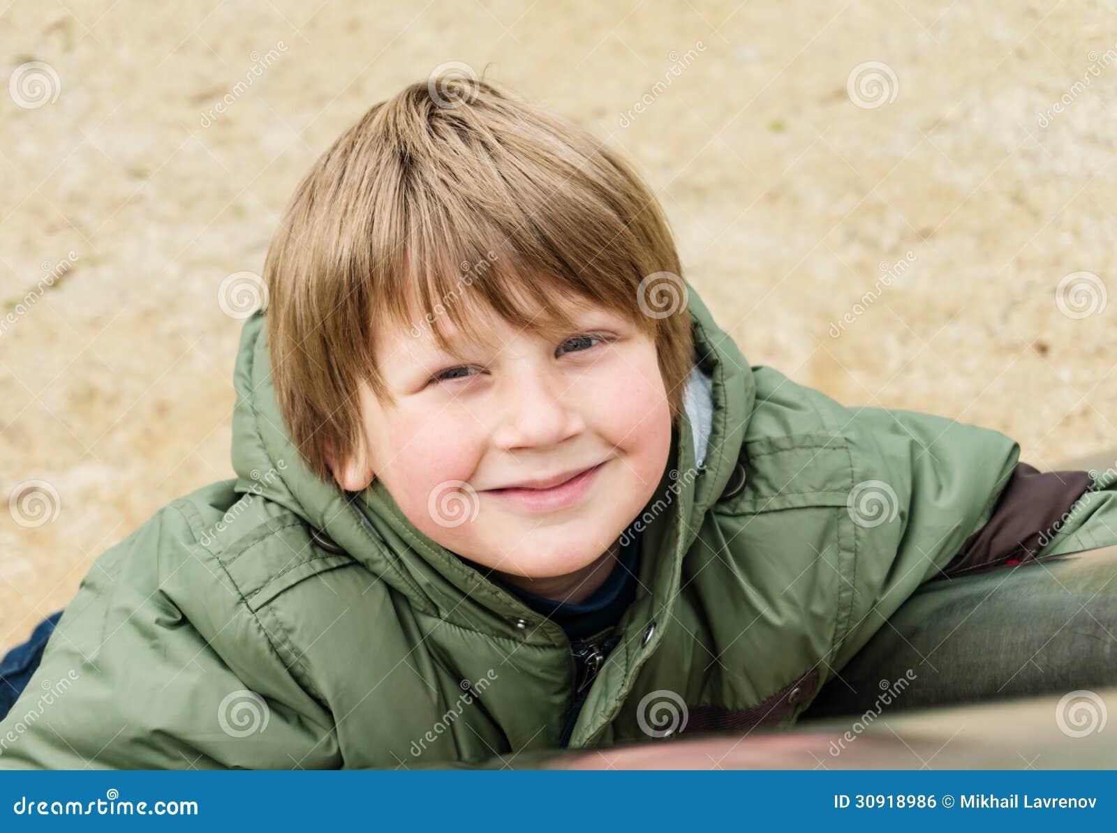 Blond boy enjoying outdoor playground