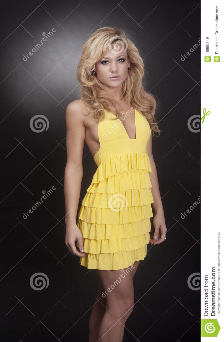 Blond Fashion Model Wearing Yellow Dress Royalty Free