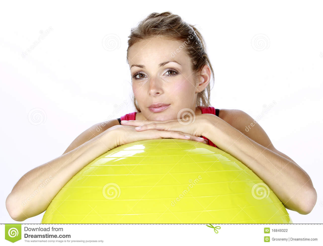Fitness sport girl with a swiss ball isolated on a white background