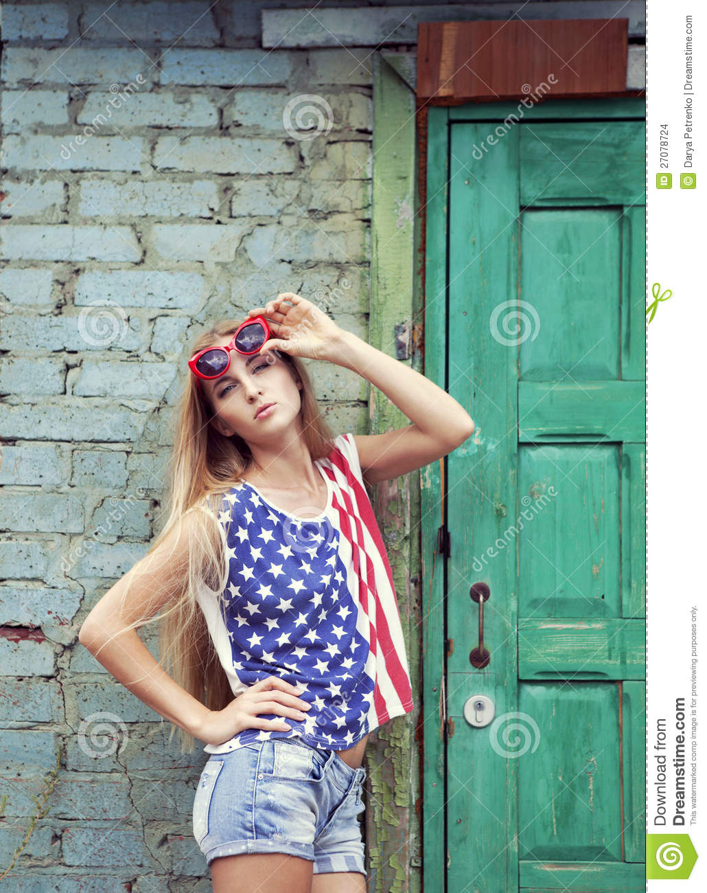 ... holds hands on her glasses wearing closses in american retro style