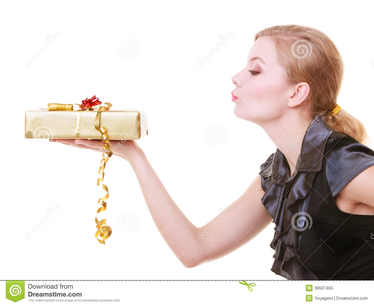 Blond girl in black dress holding red christmas gift box blowing kiss