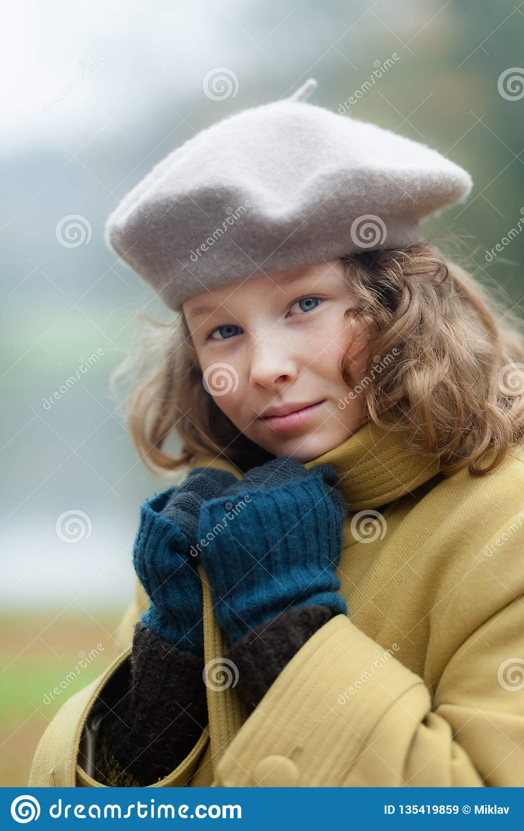 Blond girl in a cold autumn day