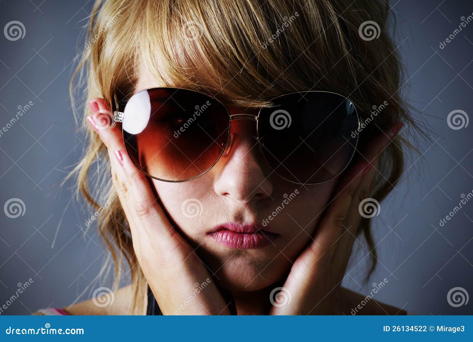 Tempting follow of blond teen holding sunglasses GIRL