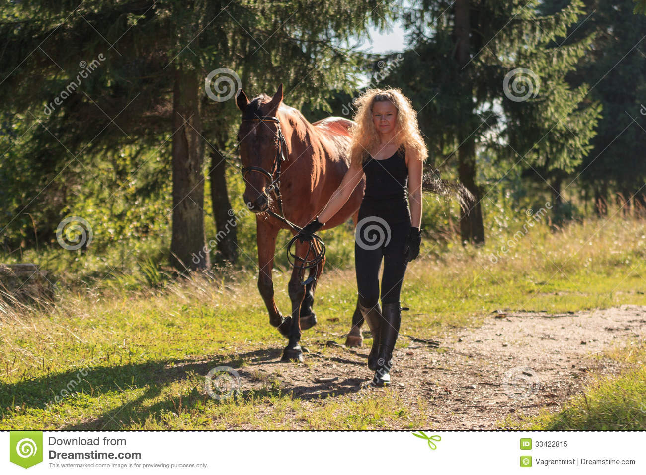 Blond Girl Leads The Horse By The Reins Royalty Free Stock