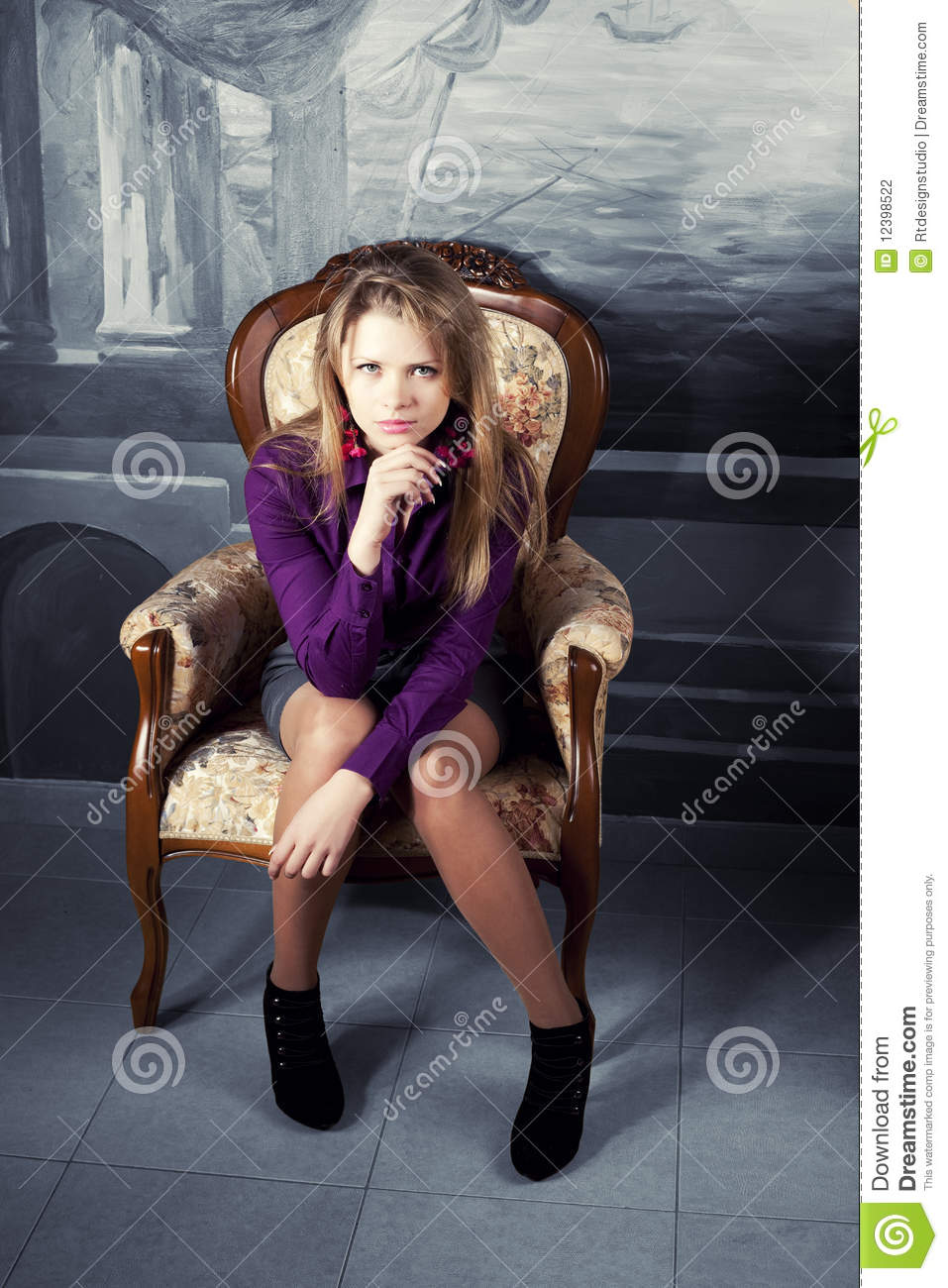 Woman sitting in armchair luxury vintage royalty free for Sitting in armchair
