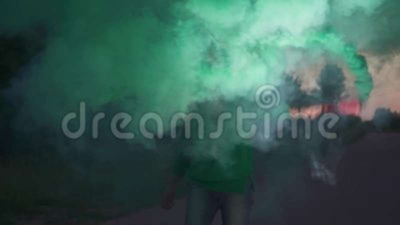 Blond Girl Is Spraying Colored Smoke Bomb In The Evening Stock Video