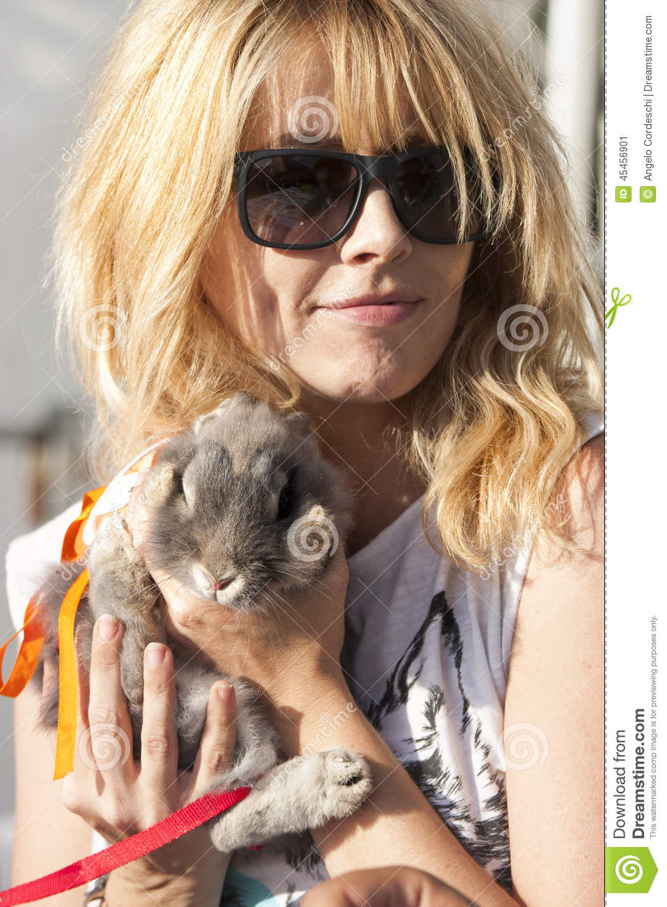 Blond Hair Woman With Sunglasses Holding Cute Pet Bunny