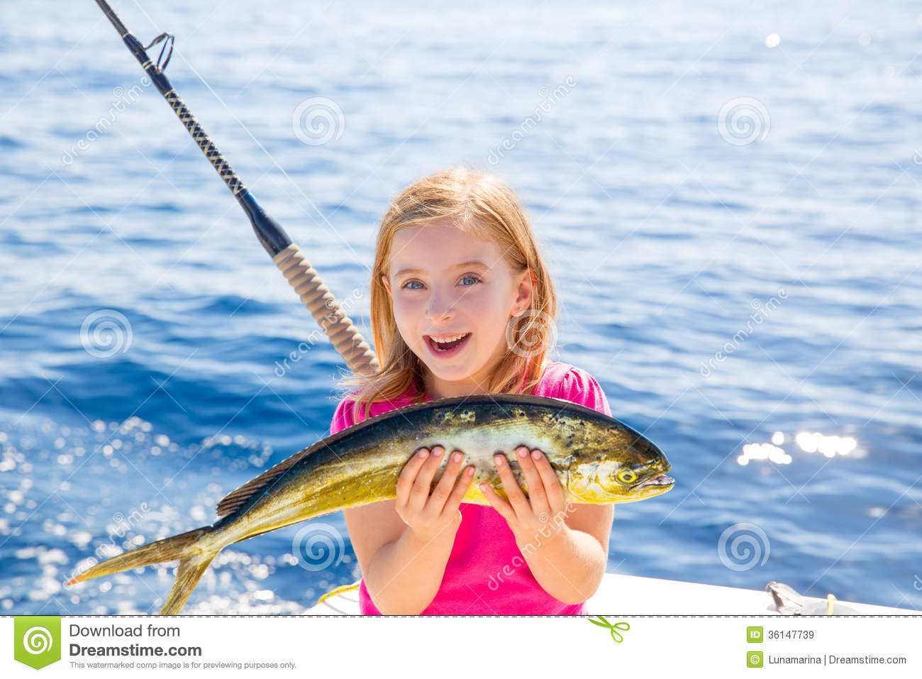 Blond kid girl fishing dorado mahi mahi fish happy catch for Fish for girls