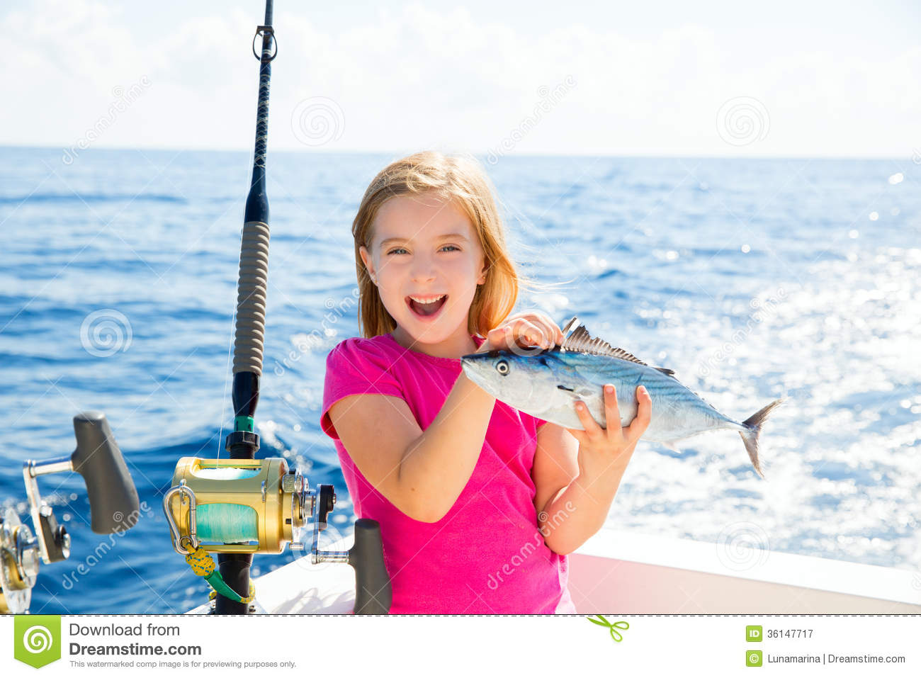 Blond kid girl fishing tuna bonito sarda fish happy catch for Fish for girls