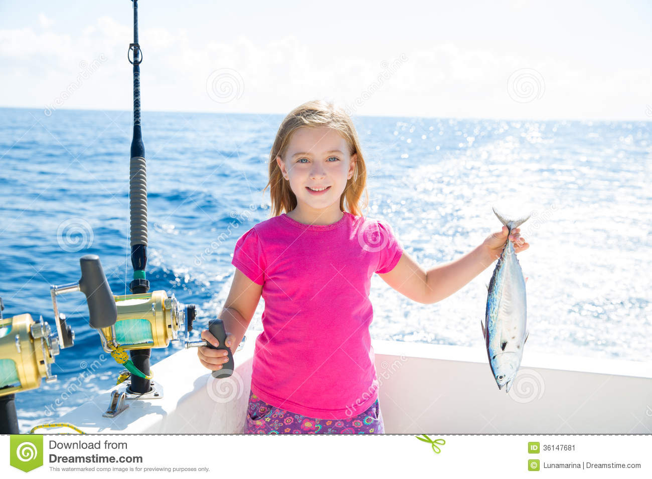 Blond kid girl fishing tuna little tunny happy with catch for Little girl fishing pole