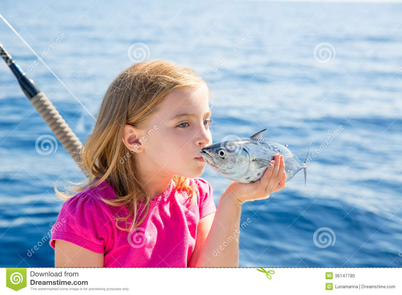 Blond kid girl fishing tuna little tunny kissing for for Fish for girls