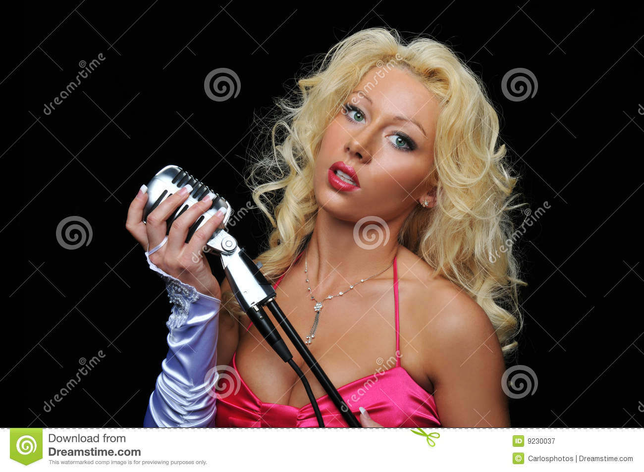 Blond singer on microphone