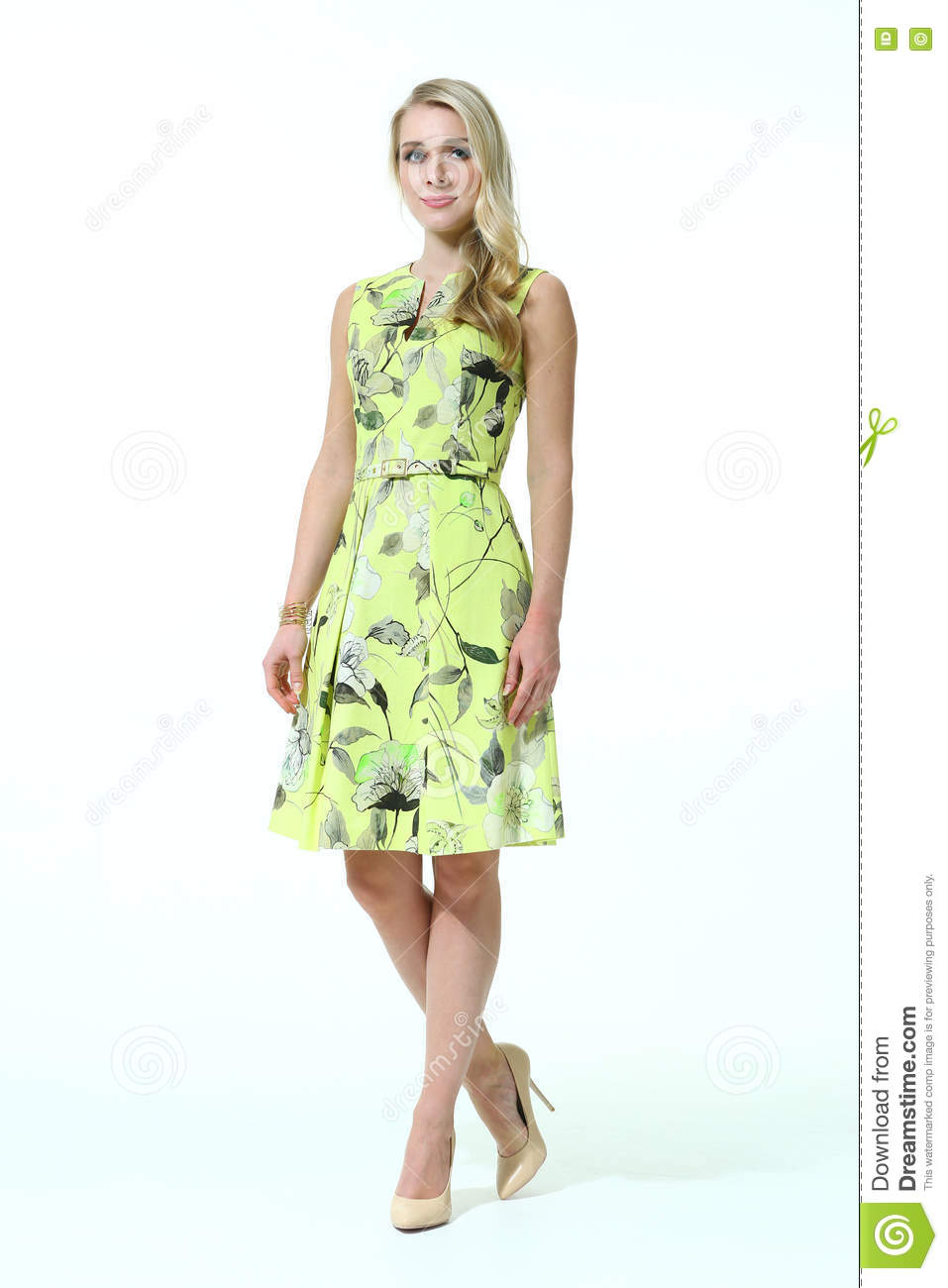 386c925d65dbe0 Blond slavic business executive woman with straight hair style in summer  print yellow sleeveless dress high heel shoes going full body length  isolated on ...