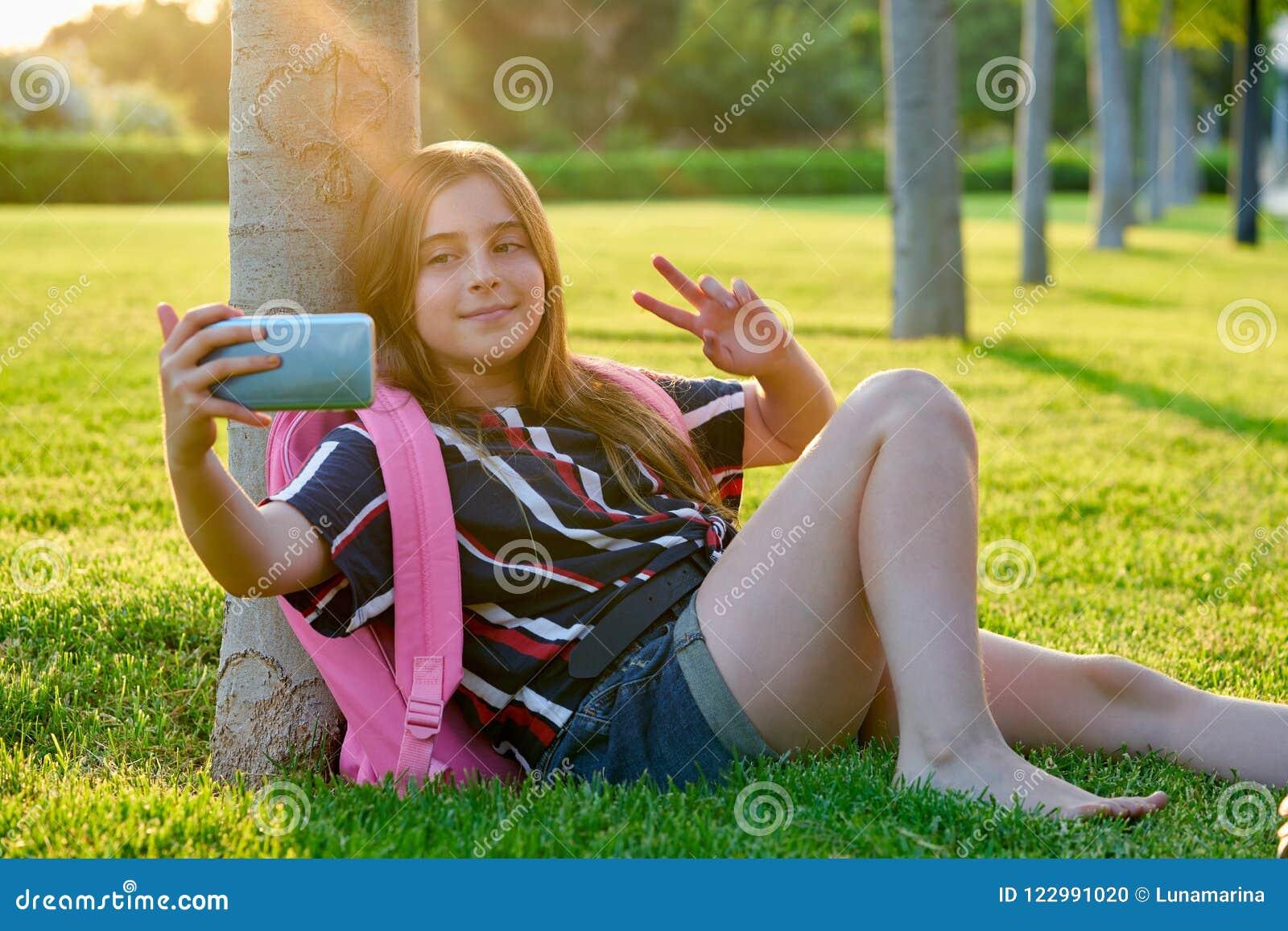 https://thumbs.dreamstime.com/z/blond-student-kid-girl-smartphone-park-back-to-school-sit-grass-122991020.jpg