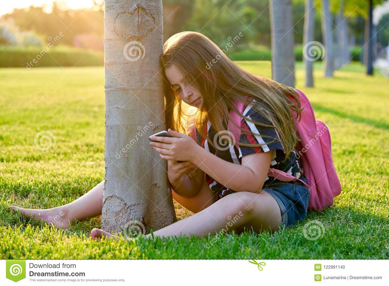 https://thumbs.dreamstime.com/z/blond-student-kid-girl-smartphone-park-back-to-school-sit-grass-blond-student-kid-girl-smartphone-park-122991140.jpg