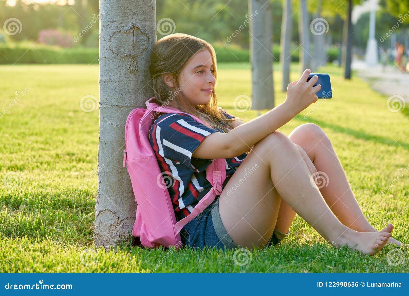 https://thumbs.dreamstime.com/z/blond-student-kid-girl-smartphone-park-blond-student-kid-girl-smartphone-park-back-to-school-sit-grass-122990636.jpg