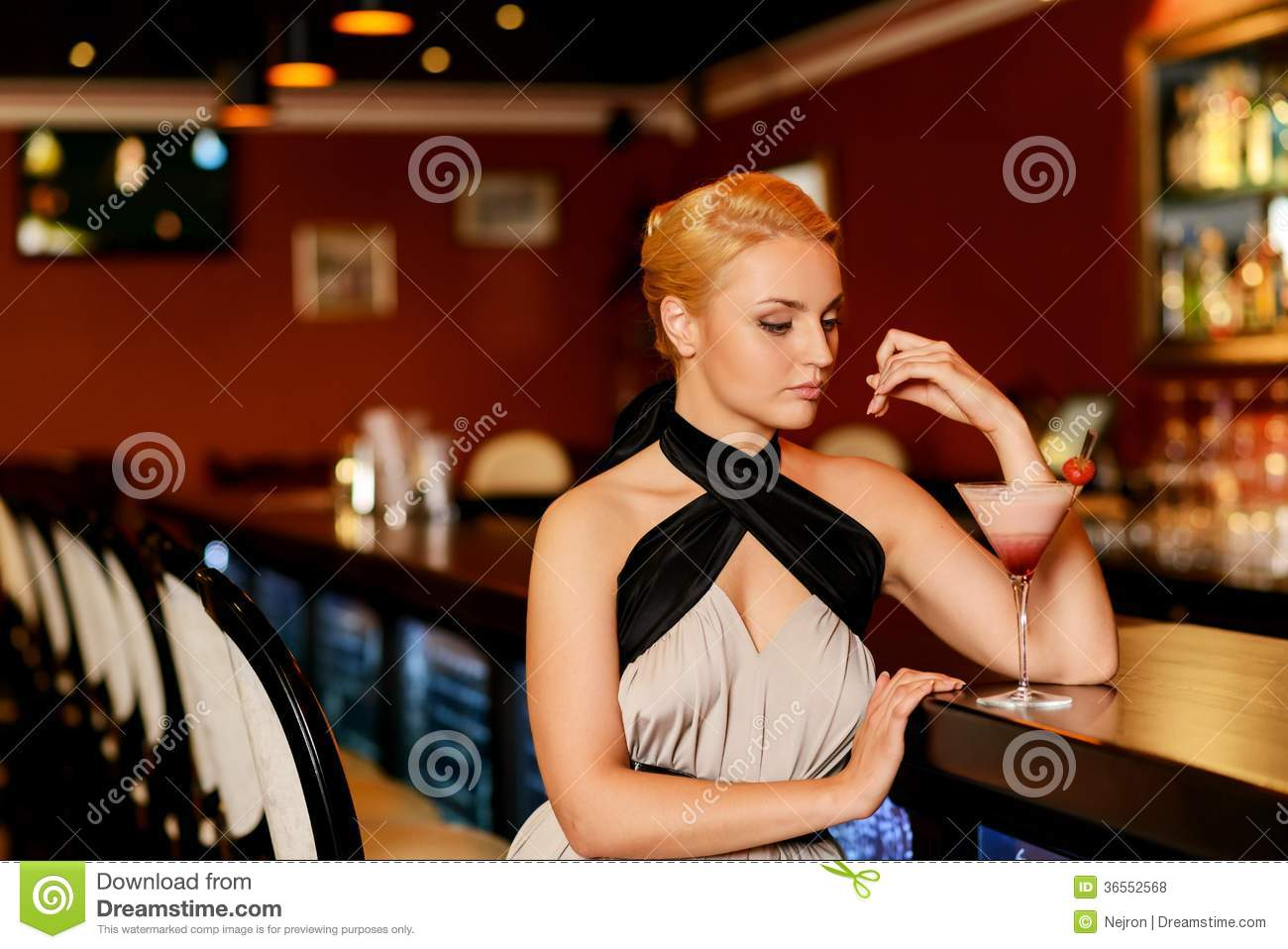 Woman With Cocktail In A Bar In Evening Dress Royalty-Free ...