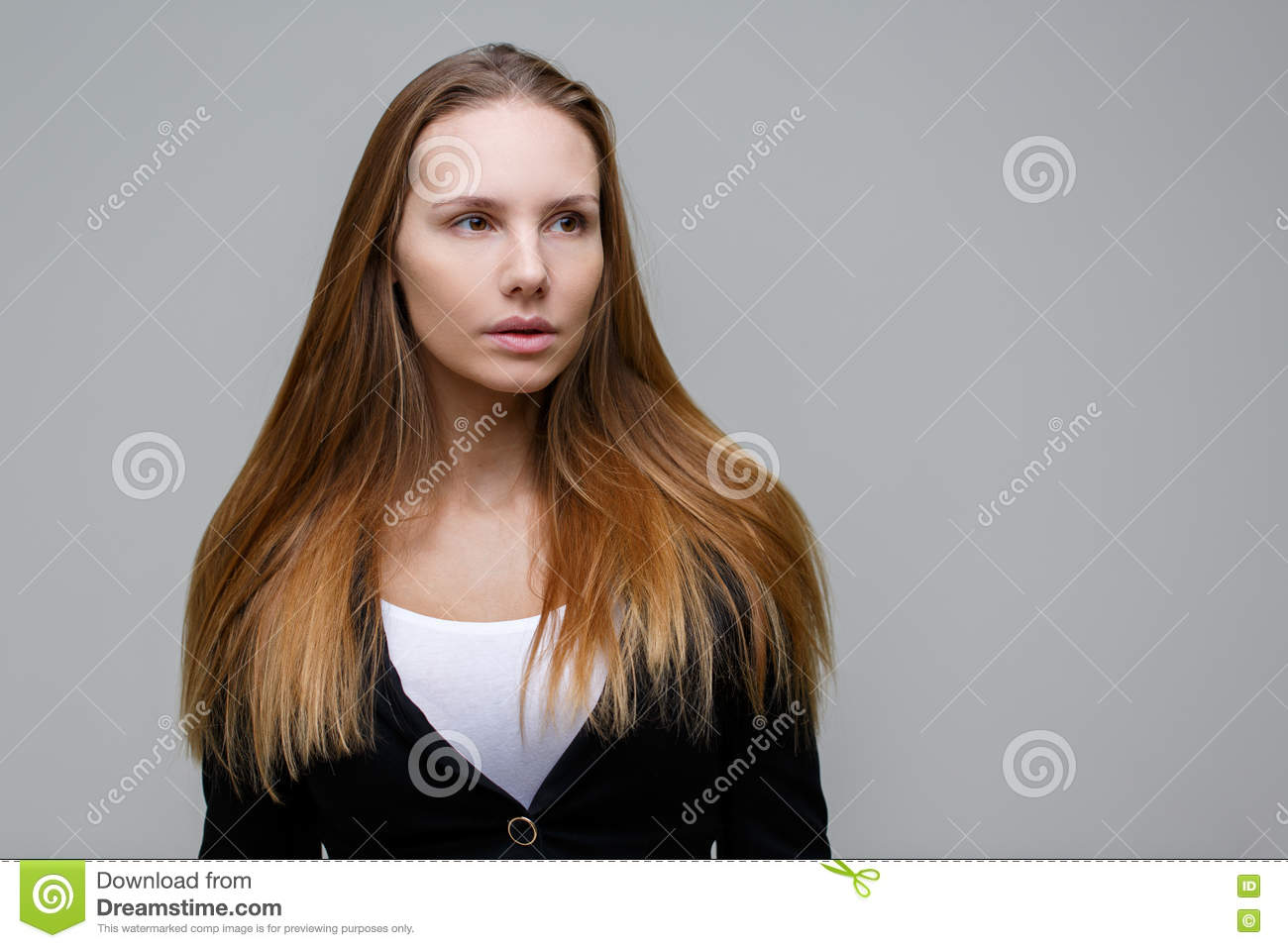 Blond woman on gray background