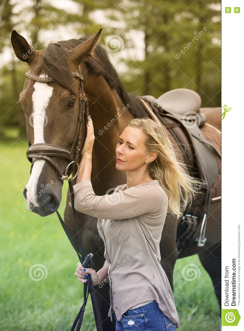 Blond woman and her horse in nature