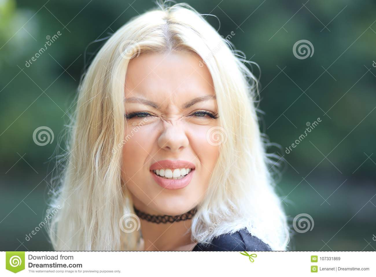 Blond woman making face
