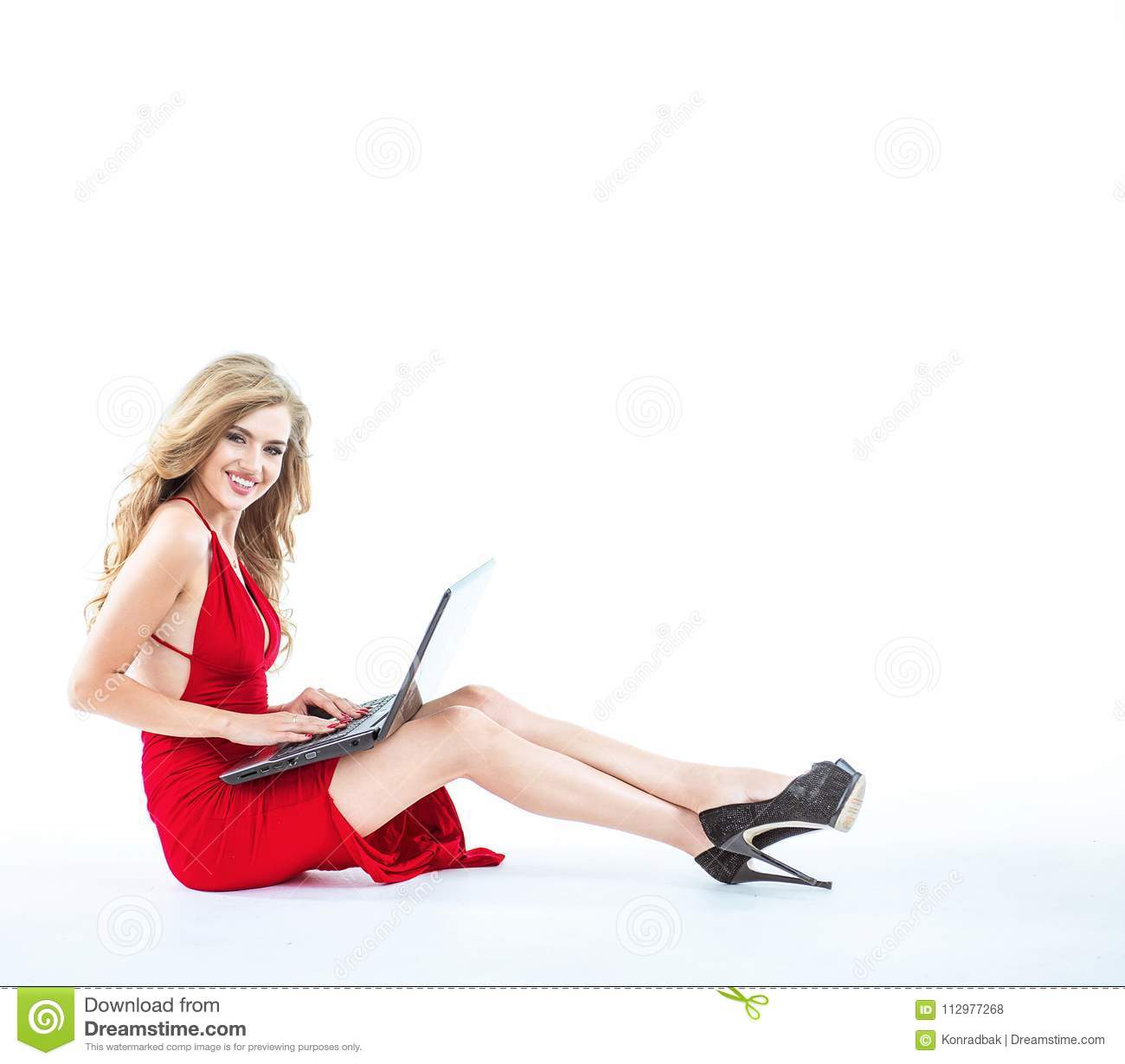 Blond lady using a notebook - isolated