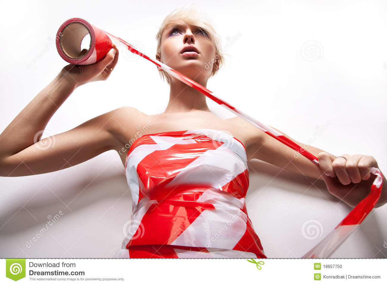 blond woman with warning tape